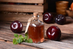 Prune juice in small bottle Royalty Free Stock Photography