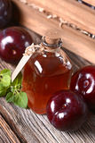 Prune juice in small bottle Stock Images