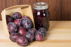 Prune plums with jar of jam Royalty Free Stock Images