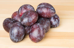 Prune plums on wooden table Stock Photo