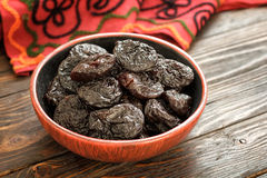Prune. In a small ceramic bowl Stock Photos