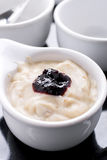 Prune yogurt. With mulberry jam on top royalty free stock image