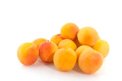 Prunes. Yellow prunes isolated over white royalty free stock image