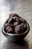 Prunes in Black Bowl Stock Images