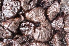 Prunes black, full frame. Prunes black, Dried fruits - close-up, background, full frame stock images