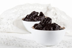 Prunes in bowls Stock Photography