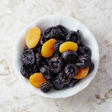Prunes and dried apricots in bowl Royalty Free Stock Image