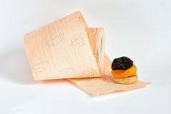 Prunes, dried apricots, fig and toilet paper. Prunes, dried apricots, fig and roll of pink toilet paper Stock Images