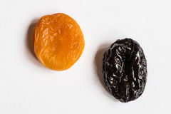 Prunes and dried apricots on a white background Royalty Free Stock Photos