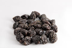 Prunes, dried fruits on a white background Royalty Free Stock Photography