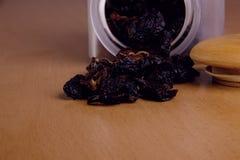 Prunes in a glass jar Stock Photos