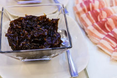 Prune marmalade. Prunes marmalade in a glass bowl Royalty Free Stock Image