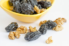 Prunes with nuts. In bowl on white background stock photos