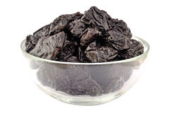 Prunes in a plate Stock Image