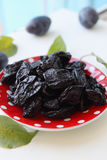 Prunes on a plate Royalty Free Stock Images
