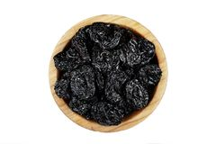 Prunes in a plate isolated. On a white background Royalty Free Stock Image