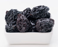 Prunes in small porcelain tray Stock Images