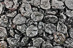 Prunes texture. The texture of a black dried prunes stock image