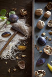 Prunes with waltnuts on rustic background with wooden table Royalty Free Stock Photography