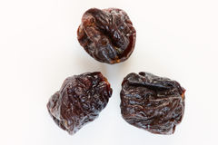Prunes on a white background Royalty Free Stock Photos