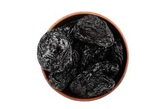 Prunes on white background. Prunes in a plate isolated on a white background Stock Photo