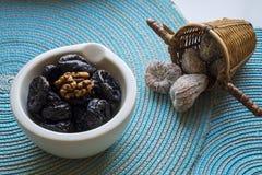 Prunes in white ceramic bowl landscape Stock Photos