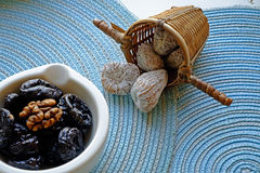 Prunes in white ceramic bowl landscape wide crop Stock Photos