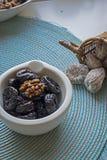 Prunes in white ceramic bowl portrait Royalty Free Stock Image