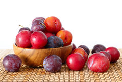 Prunes in a wooden bowl. Stock Photos