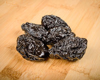 Prunes. On a wooden cutting board Royalty Free Stock Photo