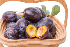 Prunes in a wooden vase Stock Image