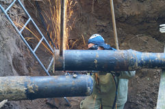 Pruning end pipes of large diameter gas cutting in the pit Royalty Free Stock Image