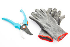 Pruning shears and gardening worn gloves Royalty Free Stock Photography
