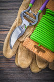 Pruning shears safety gloves soft wire tie on wood board gardeni Royalty Free Stock Images