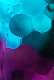 Pruple,blue  Gradient Oil drops in the water -abstract background Royalty Free Stock Photos