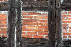 Prussian wall. Prussian brick and wooden wall Royalty Free Stock Photo