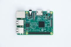 Raspberry Pi 3 Model B. Small single-board computer on white background. Royalty Free Stock Photos
