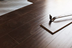Pry Bar Tool with New Laminate Flooring Stock Images