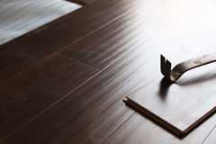 Pry Bar Tool with New Laminate Flooring Stock Image