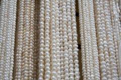 Pryda med pärlor halsband Arkivfoton