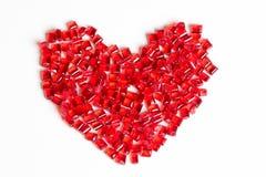 Pryder med pärlor hjärta på vit bakgrund Fotografering för Bildbyråer