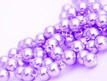 pryder med pärlor purple arkivbild