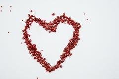 Pryder med pärlor samlingen i en form av en hjärta Royaltyfria Foton