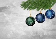 Prydnad för tre jul på en texturerad bakgrund Royaltyfri Fotografi