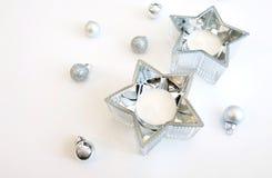 Prydnader för julbildsilver och garnering för silverstjärnastearinljus royaltyfri foto