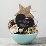 Prydnader och glad jul för text i fransman royaltyfri fotografi