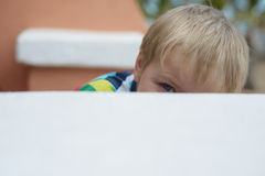 Prying boy Stock Images