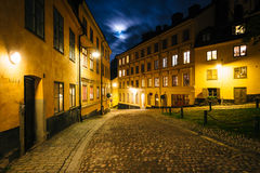 Pryssgränd, a cobblestone street at night, near Slussen, in Sö Stock Photography