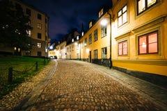 Pryssgränd, a cobblestone street at night, near Slussen, in Sö Royalty Free Stock Photos