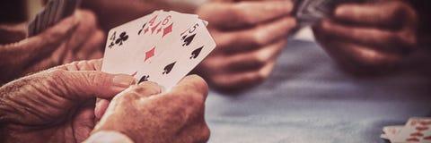 Przechodzić na emeryturę ludzie karta do gry zdjęcia royalty free